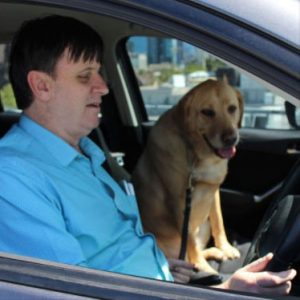 Steve in car with dog